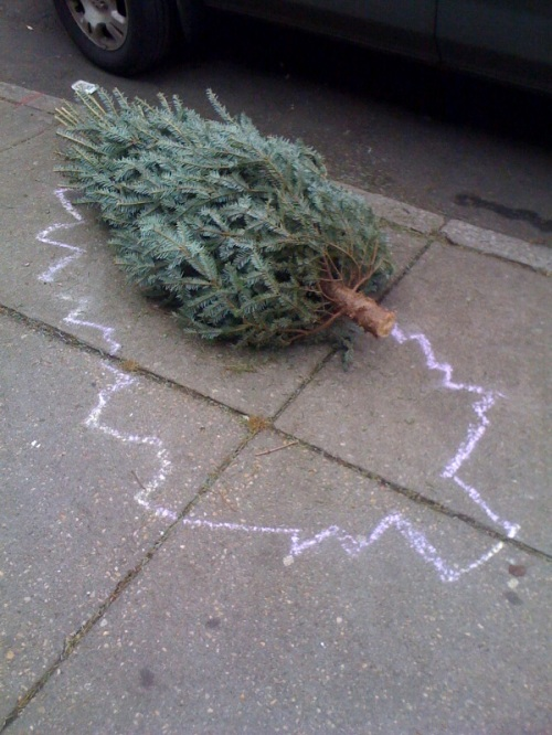 Christmas tree on sidewalk with chalk outline